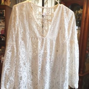 Lacy, long sleeve size small, looks like sm/med